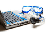Snorkel and laptop — Stock Photo