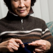Senior woman knitting — Stock Photo #5092206