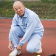 Stock Photo: Senior tennis player