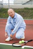 Senior tennis player — Stock Photo