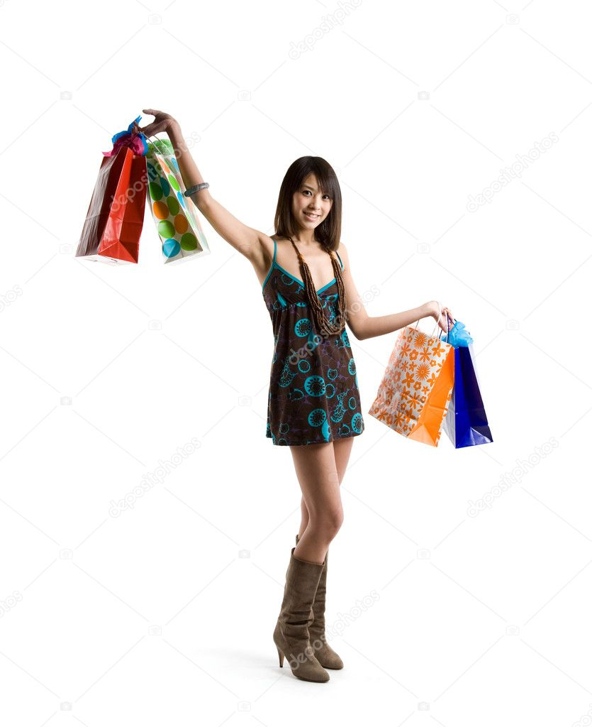 An isolated shot of a beautiful asian woman carrying shopping bags — Stock Photo #5091650