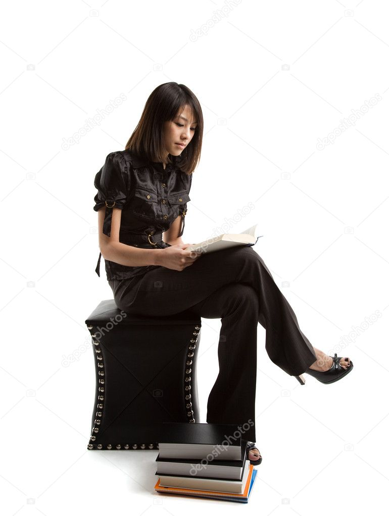 An isolated shot of an asian student studying   Stock Photo #5091712