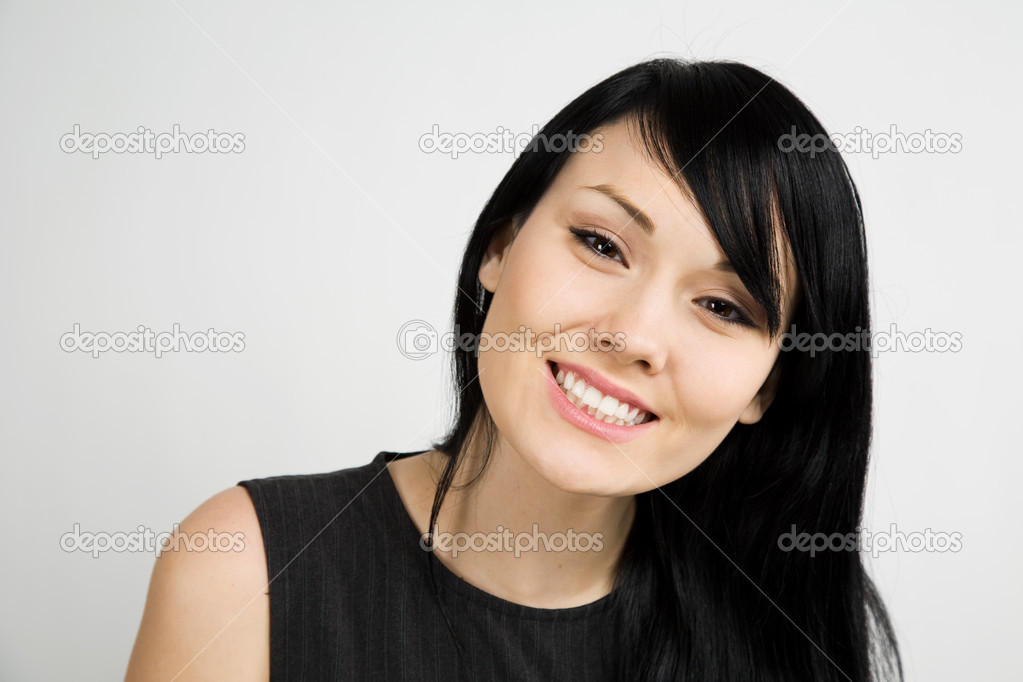 A headshot of a beautiful smiling businesswoman — Stock Photo #5092101