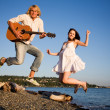 Jumping couple in happiness — Stock Photo