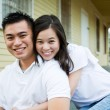 Asian couple in front of their house — Stock Photo #5452915