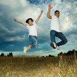 Asian couple jumping in joy - Stockfoto