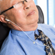 Relaxed senior asian businessman — Stock Photo