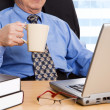 Stock Photo: Working mature businessman