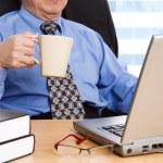 Working mature businessman — Stock Photo