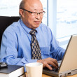 Working senior asian businessman — Foto de Stock