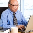 Working senior asian businessman — 图库照片 #5453311