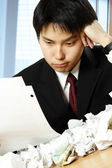 Stressed asian businessman — Stock Photo