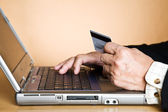 Senior businessman buying online — Stock Photo