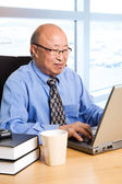 Working senior asian businessman — Stock Photo