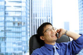Asian businessman on the phone — Stock Photo