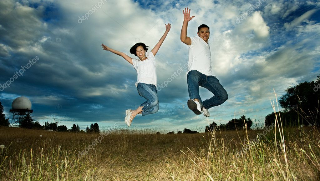 A shot of an asian couple jumping for joy  Stock Photo #5452922