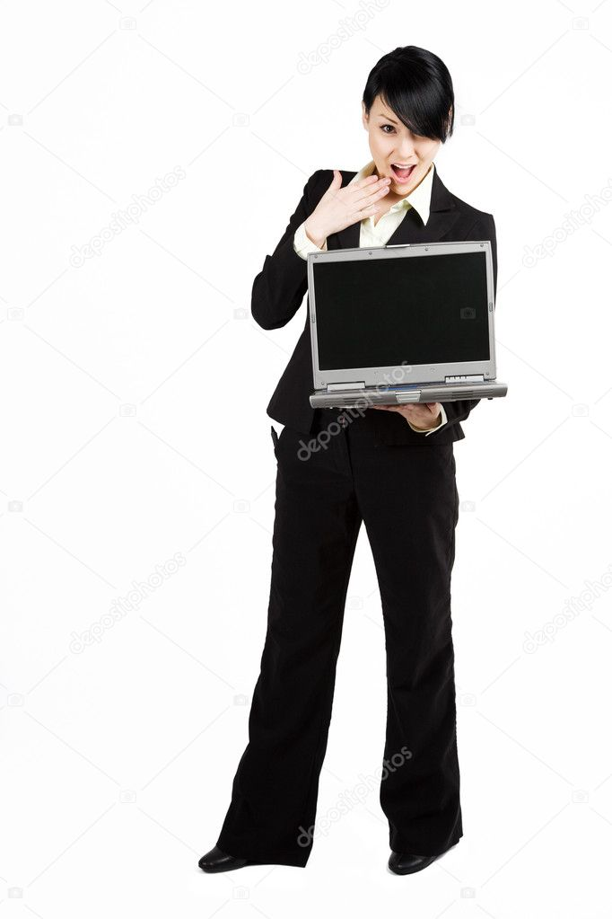 An isolated shot of a surprised businesswoman carrying a laptop — Stock Photo #5453359
