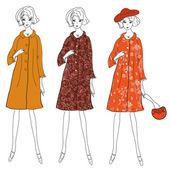 Fashion girls in winter coats — Stock Vector