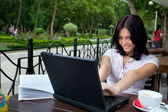 Girl with laptop in cafe — Stock Photo