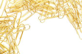 Gleaming golden paperclip — Stock Photo