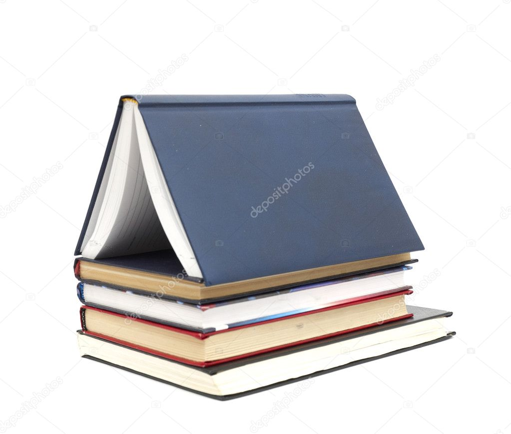 House made with books piled on white background — Stock Photo #4378956