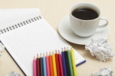 Coffee cup and spiral notebook — Stock fotografie