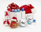Santa hat and gift — Stock Photo