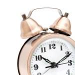 Isolated bronze vintage alarm clock — Stock Photo