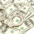 Handcuffs on money background, — Stock Photo