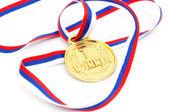 Złoty medal na białym tle — Zdjęcie stockowe
