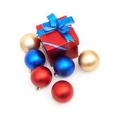 Matt christmas balls and red gift box — Stock Photo