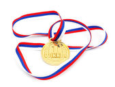 Golden medal isolated on white — Stock Photo
