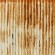 Rusty old corrugated iron fence — 图库照片