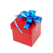 Red gift box with blue bow — Stock Photo