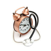 Stethoscope and clock — Stock Photo