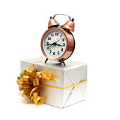 A retro clock with presents — Stock Photo