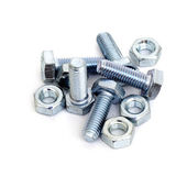 Nuts and bolts on white — Stock Photo
