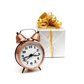A retro clock with presents — Stock Photo