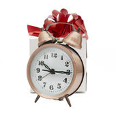 A retro clock with presents — Stok fotoğraf