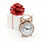 A retro clock with presents — Stock fotografie