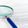 Magnifying Glass and document — Stock Photo