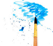 Brush with blue paint stroke — Stok fotoğraf