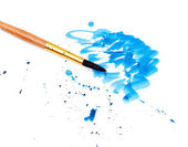 Brush with blue paint stroke — Stock Photo