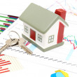 Housing market concept image with graph - Stock Photo