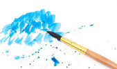 Brush with blue paint stroke — 图库照片