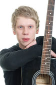Young handsome guy with a guitar. — Stock Photo