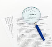 Blue Magnifying Glass and document — Stock Photo