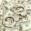 Handcuffs on money background — Stock Photo
