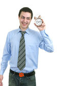 Businessman with an alarm clock in a hand — Stock Photo