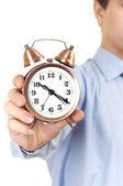 Businessman with an alarm clock — Stock Photo